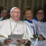 Pope Francis laughs with the Choir